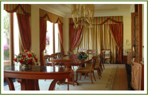Drapes used to separate dining room from entry hall